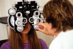 A professional optometrist working.